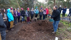 Gord Baird shares the magic of composted humanure with excited onlookers at Eco-Sense